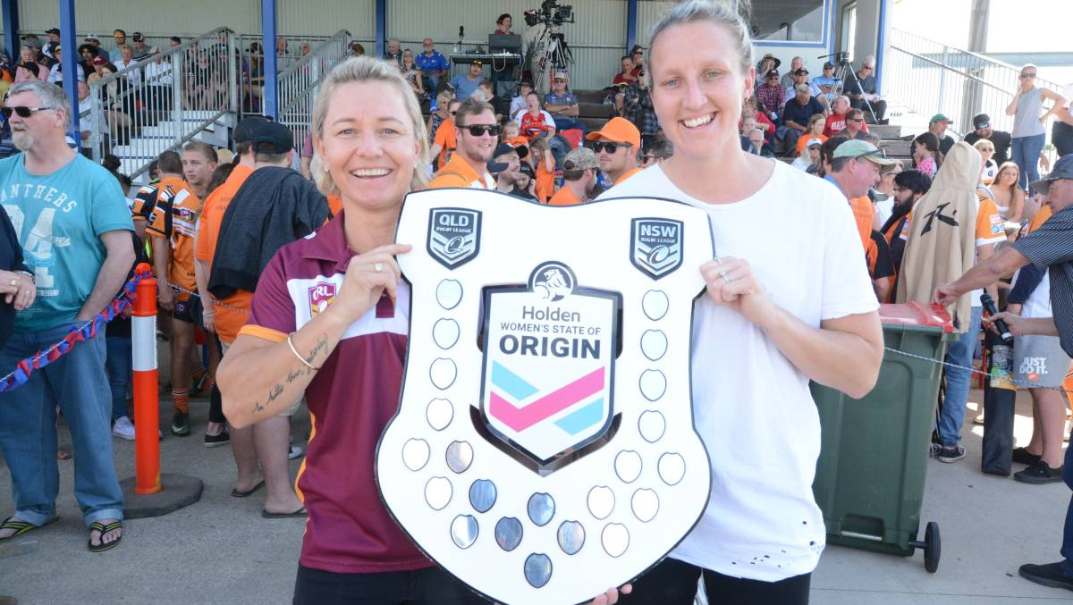 Kylie Hilder (left) and fellow NSW State of Origin representative Holli Wheeler with the State of Origin shield at last year's Group Three grand final, where the shield was on display.