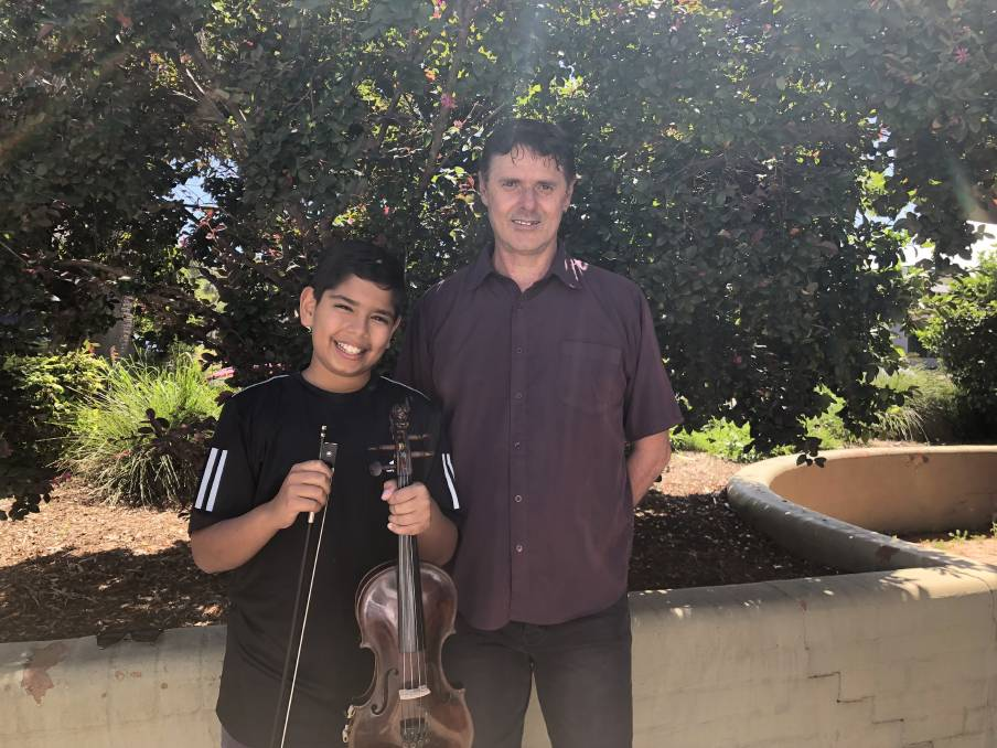 Scholarship winner and soloist, Cornell Estibeiros with Sinfonia conductor, Iain Pole